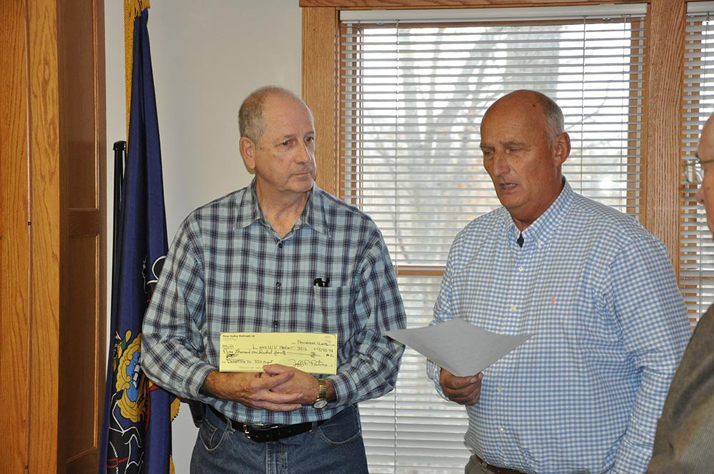 Jeff Pontius of Penn Valley Railroad presents Norm Barrett with a donation check for Project3713.